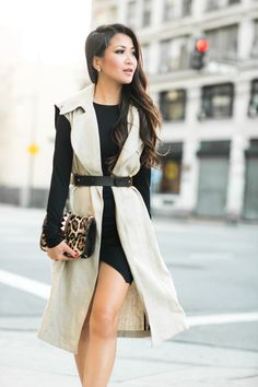 spring / summer - street style - street chic style - black bodycon dress + beige sleeveless duster coat + black belt + leopard print clutch + nude ankle strap sandals