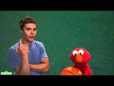 Zac Efron and Elmo practice patience.  This makes me sigh.  Le sigh.