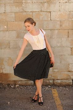 girly top, twirly polka dot skirt, cute handbag.