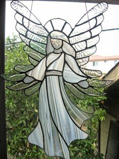 Gorgeous stained glass angel with flowing white gown and fabulous wings