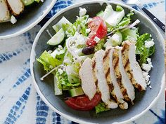 Greek Salad with Oregano Marinated Chicken: Dried oregano, garlic and lemon turn a simple salad into a Greek-inspired option for dinner tonight. Top the finished greens with grilled chicken for a complete meal.