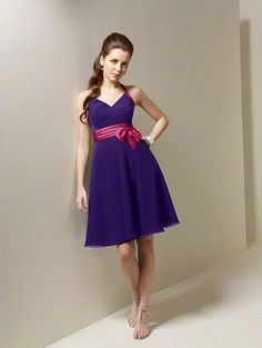 Our dress but in yellow with a red sash