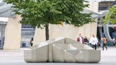 Raw Edges creates concrete armchairs for Greenwich Peninsula
