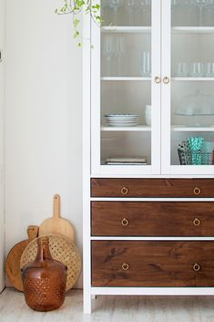 IKEA hack: glass door cabinet! Love this mid century look.