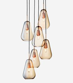 The Anoli collection is made of materials of the highest quality and crafted by skilled artisans. Its expression is simple and consists of mouth-blown drop shaped glass pendants. Bring the unique Nordic light indoor with Anoli Pendant Chandelier, Ceiling Pendant, Ceiling Lamp, Pendant Lighting, Nordic Lights, Muuto, Elegant Chandeliers, Luminaire Design, Hand Blown Glass