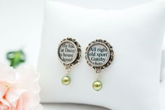 The Great Gatsby Pearl Drop Earrings - Lovely literary #earrings inspired by #TheGreatGatsby by #FScottFitzgerald. Featuring text from the book - including the names Gatsby and Daisy - and light green Swarovski pearls (representing the famous green light from the novel), these lovely pearl drop earrings add a touch of #JazzAge - era, #Gatsby glamour and #Bookish #style to almost any occasion, including #weddings and #proms. $28