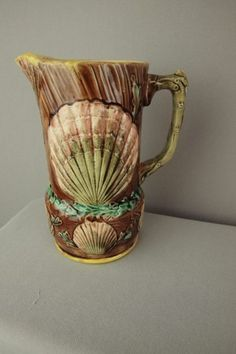 Majolica pitcher with shells and seaweed, coral handle: