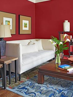 A bold color on the walls can instantly change the feeling and tone of a space. Just try imagining this room if it had white walls. Instead, the rich red color succeeds in balancing the airy blue and white accents, plus it bridges the gap between a series of different wood tones. The Color: Red Bay, SW6321 -- Sherwin-Williams/