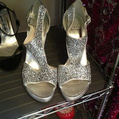 Stuart Weitzman Silver Glitter T-strap Open Toes Gorgeous Stuarts just waiting to be shown off!  I bought these sight unseen but when I got them they were too small!  Never been worn!  My loss is your gain! Stuart Weitzman Shoes