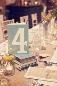 Old books used as table numbers-So Cute by RCFreire