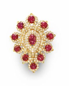 A RUBY AND DIAMOND BROOCH, BY VAN CLEEF & ARPELS   Designed as a circular-cut diamond foliate plaque, centering upon an oval cabochon ruby, extending ten oval and circular cabochon rubies, mounted in gold, (with pendant hoop for suspension), in a Van Cleef & Arpels cream silk pouch  Signed Van Cleef & Arpels, N.Y., no. 3201 S.O.