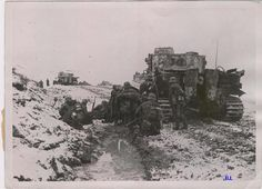 German troops using Tiger tanks for cover.