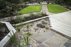 Chunky Oak Decking. A modern garden using traditional techniques. For a free, no obligation consultation with an expert call us now on 0113 262 1214  http://www.jblandscapesltd.com/