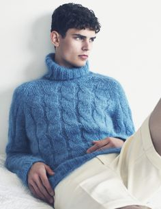 Beautiful blue cable-knit turtleneck dude sweater.  There is something about black haired guys with blue eyes in blue sweaters.  Add some blue type cologne, such as Davidoff's Cool Water or Polo's Blue and I am liable to pass out.