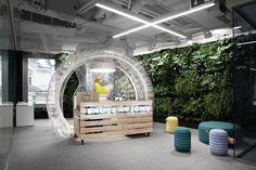 The pine-slat reception desk at the new Bausch  Lomb offices in Warsaw, Poland, is encased in an inflated vinyl bubble.