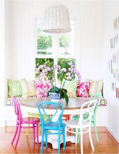Mix-matched, brightly colored chairs in the dining nook.