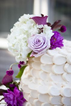 Cape Cod Wedding. Wedding Cake with Purple Flowers. Wedding Reception Decor Details. BKB & CO. is an award-winning wedding photography and cinematography firm located at 213 Newbury Street Boston, Massachusetts. Their work has been featured in countless nationally-published trades including BRIDES, The Knot, Boston Magazine and many more.
