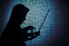 Computer hacker silhouette. - Bill Hinton/Getty Images