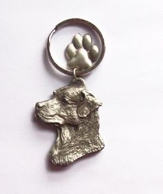 Chesapeake Bay Retriever keyring with cute paw charm - ideal gifts. Made from pewter.  Chesapeake Bay Retriever stamped on back, also dog paws.