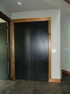 Black interior doors with wood (not white) trim.
