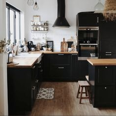 my scandinavian home: A Home In The South of France With a Lovely Black Kitchen Black Kitchen Cabinets black France home kitchen LOVELY Scandinavian South Black Kitchen Cabinets, Black Kitchens, Kitchen Black, Black Kitchen Furniture, Butcher Block Countertops Kitchen, Upper Cabinets, Kitchen Shelves, Wood Cabinets, Cottage Kitchens