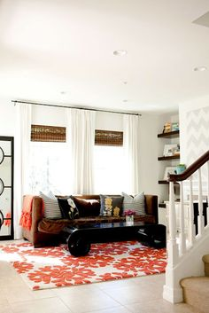 blinds & white curtains paired with dark woven wood shades