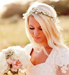 Bride's casual down hair with flower crown wedding. Big one for ceremony and small one like this for reception.