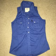 Abercrombie and Fitch button up Sleeveless button up shirt. It's really cute and you have so many choices of outfit switches with it. Abercrombie & Fitch Tops Button Down Shirts