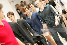 Russian designer Moritz Rogosky (R) walks on the catwalk after his show, 02 July 2005 in Paris, during the spring-summer 2006 Men pret-a-porter collection show.