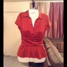 """BCBG Maxazria SILK Blend Top BCBG Maxazria Top is made of 95% Silk and 5% Spandex. Size XS. Burnt Orange color. Zipper up the left side. 2 Button front. Tie back. Length """"24. Laying flat """"16. This item is NOT new, It is used and in Good condition. Authentic and from a Smoke And Pet free home. All Offers through the offer button ONLY.  Ask any questions BEFORE purchase. Please use the Offer button, I WILL NOT negotiate in the comment section. Thank You BCBGMaxAzria Tops"""