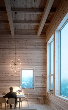 Rever & Drage Architects has created a tall and slim wooden house named Zieglers Nest overlooking the city of Molde and the Moldefjord on the western coast of Norway.