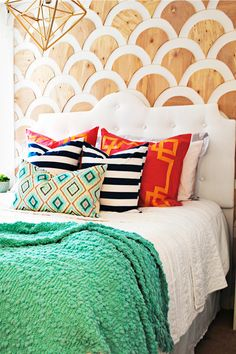 Place a two-inch strip of mounting tape on the back of each scallop. Line up with the smaller outlines on your wall and attach.  - GoodHousekeeping.com