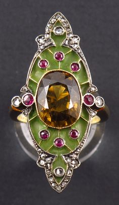 An Art Nouveau gold, silver, enamel, diamond and gem set (probably spinel) ring, about 1900. #ArtNouveau #ring