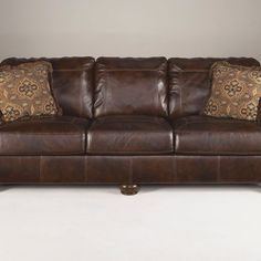 That Furniture Outlet - Minnesota's #1 Furniture Outlet. We have exceptionally low everyday prices in a very relaxed shopping atmosphere. Ashley Axiom Walnut Leather Sofa thatfurnitureoutlet.com #thatfurnitureoutlet  #thatfurniture  High Quality. Terrific Selection. Exceptional Prices.