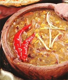 A pot of pulses seasoned with simple spices was lit up with firewood and simmered for several hours to make this dal preparation. The cooks would have a meal ready around the time the maharaja returned from shikaar. It would consist of this dal, along with a meat preparation eaten with rotis.  This is a quicker version of the traditional recipe but tastes just as delicious.