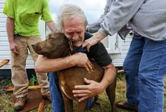 Greg Cook hugs his dog Coco after finding her inside his destroyed home in the East Limestone, Ala. on Friday, March 2, 2012. #tornado