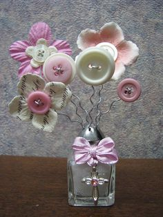 """Solemn Pink ~~~~~~~~~~~~~~~~~~~~ I love creating what I call my """"Button-Lee"""" Bouquets. They measure anywhere from 1-15 in height. Prices range from $3 to $75. Each one I make, I take great pride in. It takes days to weeks to create them. Some have even taken a month. I want them to be"""