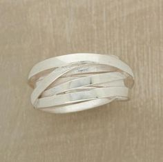 """Meandering strips of sterling silver, some textured and some smooth, crisscross to create a chunky, irregular band. Tapers 3/8"""" to 1/4""""W. Whole sizes 6 to 10."""