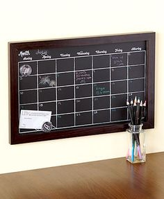 Organize your life using this Magnetic Chalk Calendar and Pencil Set. Effortlessly plan out your month with this easy-to-read chalkboard. The thick frame features a built-in chalk tray. Includes magnets for pinning up notes and mounting hardware for