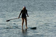 File:Woman stand up paddle surfing.jpg