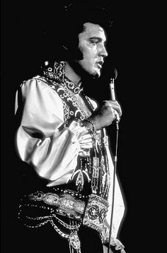 Elvis Presley performing at the Nausau Coliseum, 7/19/75.  Aztec Jumpsuit