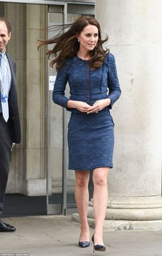 The Duchess recycled a favourite blue tweed suit by Rebecca Taylor, teamed with navy heels...