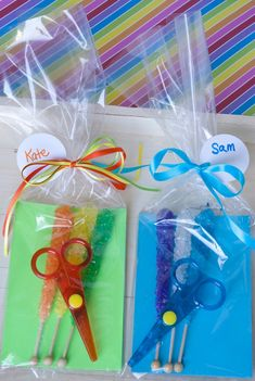 Rock, Paper, Scissors Party Favors! Made with Rock Candy Sticks, Safety Scissors, and card stock. Cute for Rainbow- and craft-theme parties for kids. | Sweeterville.com
