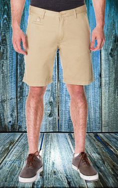 65 MCMLXV Men's Khaki Chino Short Get comfortable and noticed in our signature men's chino short. Classic straight fit with sharp detailing. Khaki color. Our khaki chino short is available in waist sizes 30/32/33/34/36/38. Imported. #ShopifyPicks