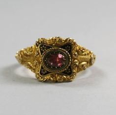 This Georgian 18k gold, pink topaz ring is dated 1822