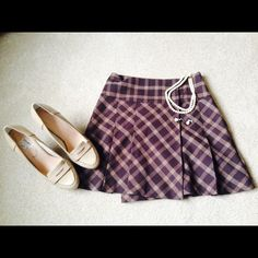 GORGEOUS PLAID SKIRT  This beautiful plaid skirt you can wear it any time. Linen inside. Bottom up in the side (see pictures). Sit just below the waist. The Limited Skirts Mini