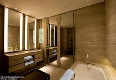 This modern wood design bathroom is great. I love the contrast of the litho and dark colors.