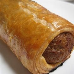 Popular as party snacks and even as meals in themselves, sausage rolls have long been a favourite food for South Africans. They are very easy to make when pre-prepared pastry is used, but this homemade version, that makes use of sour cream flaky pastry and a spicy sausage meat filling, will yield noticeably superior results.   - Sausage Rolls