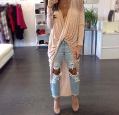 Long sleeve front twist draped high low top with ripped boyfriend jeans