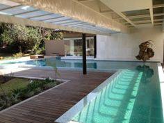 Positive Edge Pool. Piscina Borde Positivo con canal de natación, nado vs corriente, jacuzzi y asoleadero húmedo. 351- Edo. de México.